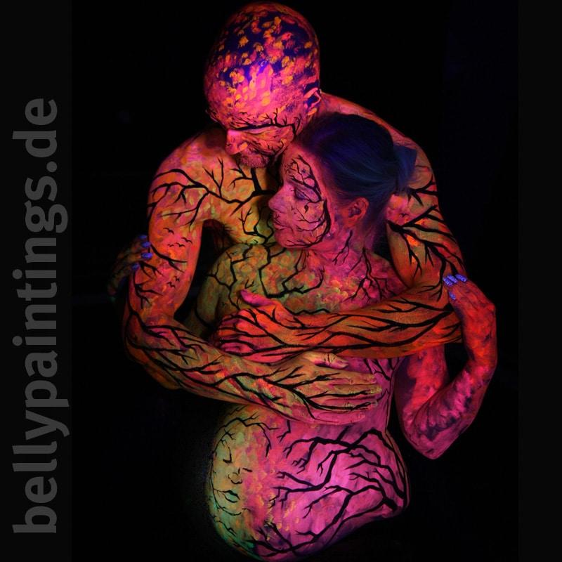 Bauchbemalung mit Neon Paar Bodypainting
